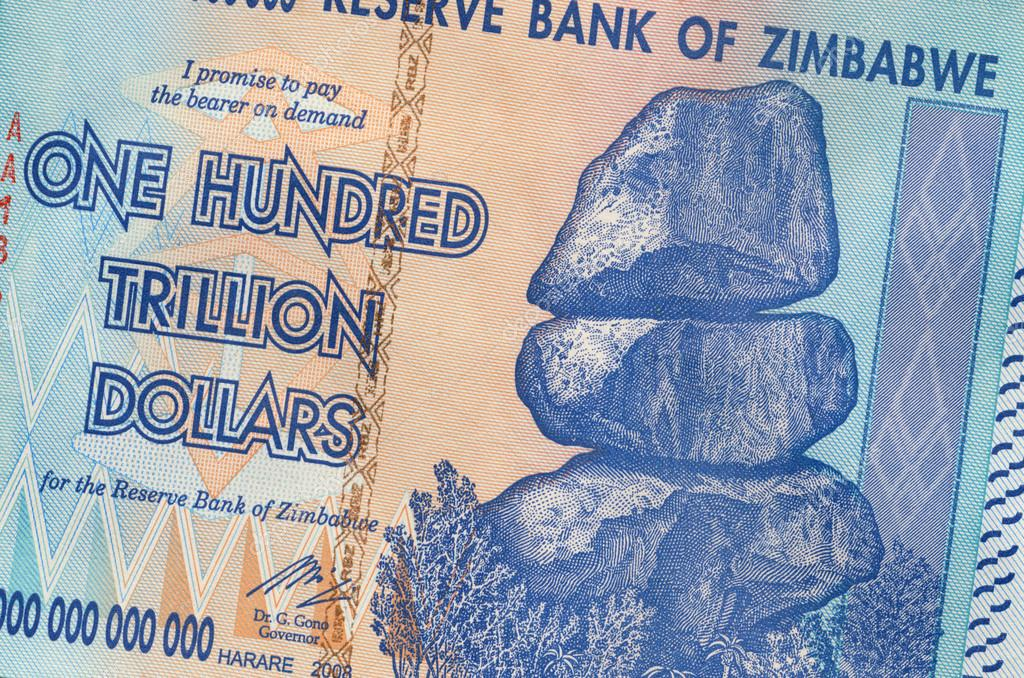 Banknote of Zimbabwe of one hundred trillion dollars. This banknote has the highest nominal value in history. The hyper inflation in Zimbabwe in 2008 and 2009 broke every record.  Foto Stock #17386911