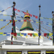 Prayer flags & Boudhanath Stupa - Kathmandu - Nepal - Stock Photo