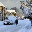 Clearing winter snow from vehicles - England — Stok fotoğraf