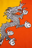 Detail on the flag of the Kingdom of Bhutan — Stock Photo