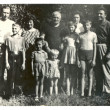 Stock Photo: Family photographs of people of different ages in a rural summer orchard