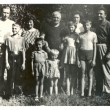 Stock Photo: Family photographs of people of different ages in rural summer orchard