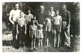 Family photographs of people of different ages in a rural summer orchard — Stock Photo