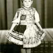 Stock Photo: Child - girl with decorated skirt (dress)