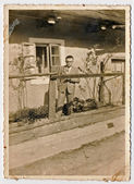 The man on the porch of an old house - villager — Stock Photo