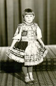Child - girl with a decorated skirt (dress) — Stock Photo