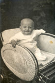 Baby in rieten pram — Stockfoto
