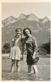 Friends - two young women standing in the middle of a mountain river — Stock Photo