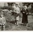 Stock Photo: Two women and boy in garden