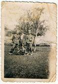 Men posing in a city park — Stock Photo