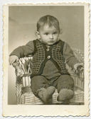 Baby on wicket chair — Stock Photo