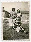 Three women and one sitting child — Stock Photo