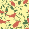 Seamless vector pattern with birds and tree branches — Stockvektor