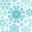Seamless snowflakes background — Stock Vector #17823301