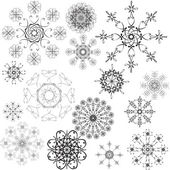 Set of openwork snowflakes — Stock Vector