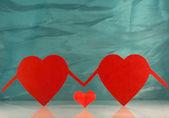 Three hearts on a light background — Stock Photo