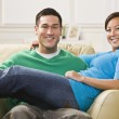 Attractive Smiling Couple on Sofa — Stock Photo