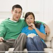 Surprised Couple Watching TV — Stock Photo #18762493