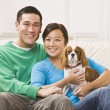 Attractive Asian Couple Holding Dog — Stock Photo