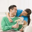 Attractive Couple Exchanging Gifts - Stock Photo