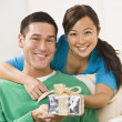 Couple Holding Present  — Stock Photo