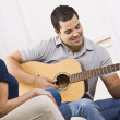 Stock Photo: Happy Young Couple with Guitar