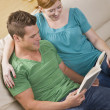 Attractive Couple Reading Together — Stock Photo