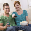 Attractive couple watching TV — Stock Photo