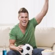 Soccer Fan Pumping His Fist While Watching the Game — Stock Photo