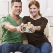 Happy Young Couple with Present — Stock Photo #18763199