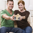 Happy Young Couple with Present — Stock Photo