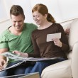 Stock Photo: Couple Looking at a Photo Album Together