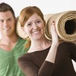 Couple Carrying Carpet Roll — Stock Photo