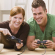 Happy Young Couple Playing Video Games — Stock Photo