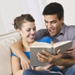 Cute Couple Reading and Laughing Together — Stock Photo