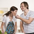 Attractive man feeding woman — Stock Photo