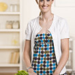 Attractive brunette in kitchen — Stock Photo