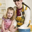 Woman and Child Kneading Dough — Stock Photo #18765829