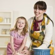Mom and daughter making bread - Stock Photo