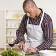 Attractive male cutting salad — Stock Photo #18766149