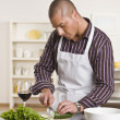 Attractive male cutting salad — Stock Photo