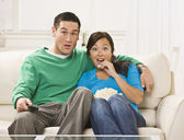 Surprised Couple Watching TV — Stock Photo