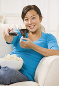 Beautiful Asian Woman Watching T.V. — Stock Photo