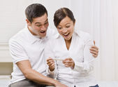 Ecstatic Couple Looking at a Pregnancy Test Together. — Foto de Stock