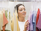 Woman Going Through Her Outfits — Stock Photo