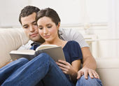 Cozy Couple Reading Book — Stock Photo