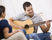 Happy Young Couple with Guitar — Stock Photo