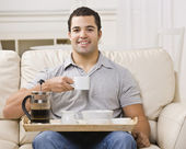 Man with Breakfast Tray and Coffee — Stock Photo