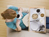 Top View of a Woman and Breakfast Tray — Stock Photo