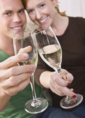 Attractive Young Couple Toasting — Stock Photo